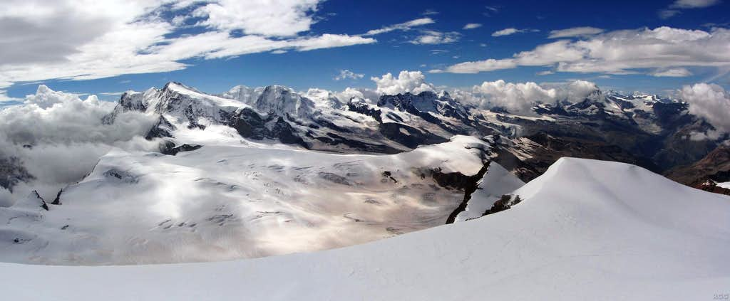 Strahlhorn summit panorama stretching from Monte Rosa to Matterhorn