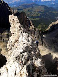A climber while reaching Pollice summit, Sassolungo