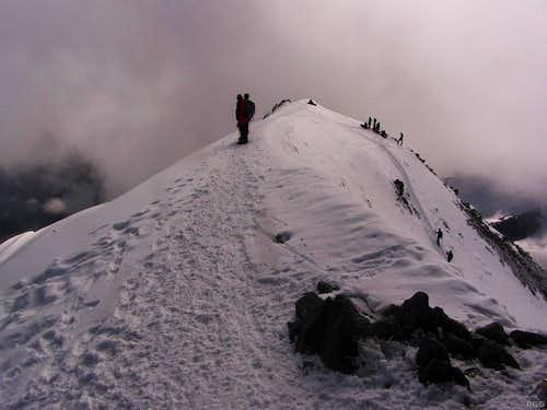 Allalinhorn summit view along the virtually flat summit ridge