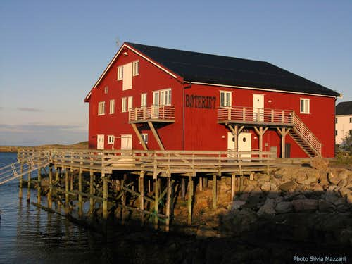 Henningsvær, a rorbuer lightened by the night-sun