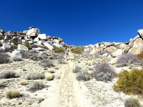 Walking up steep sandy road