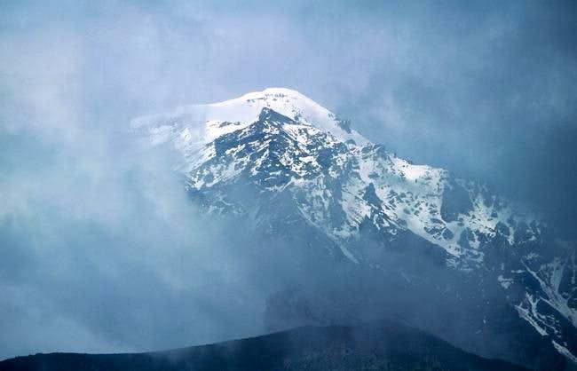 Ostry Tolbachik in clouds;...