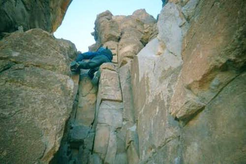 John Paterson climbing on the...
