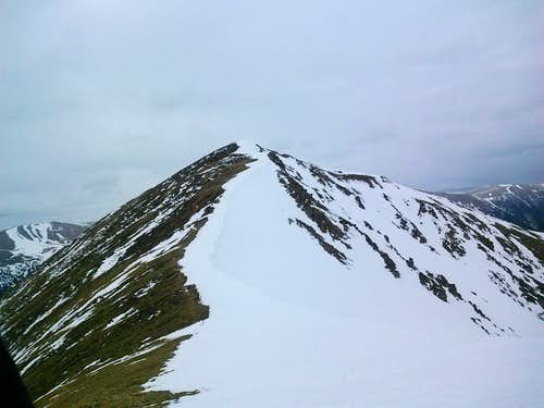 view from saddle looking up at Mount Sniktau's summit