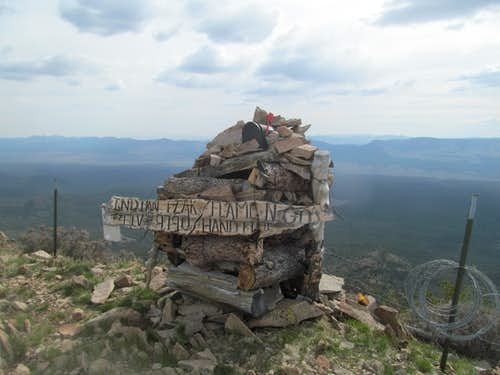 summit cairn and barbed wire