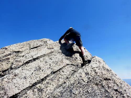Climbing the final summit rock
