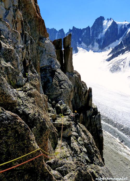 Downclimbing from the summit of Aiguille du Refuge