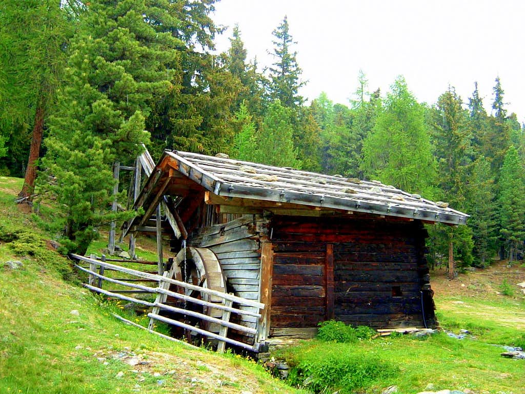 Wooden mill along Punta di Lasa Normal route