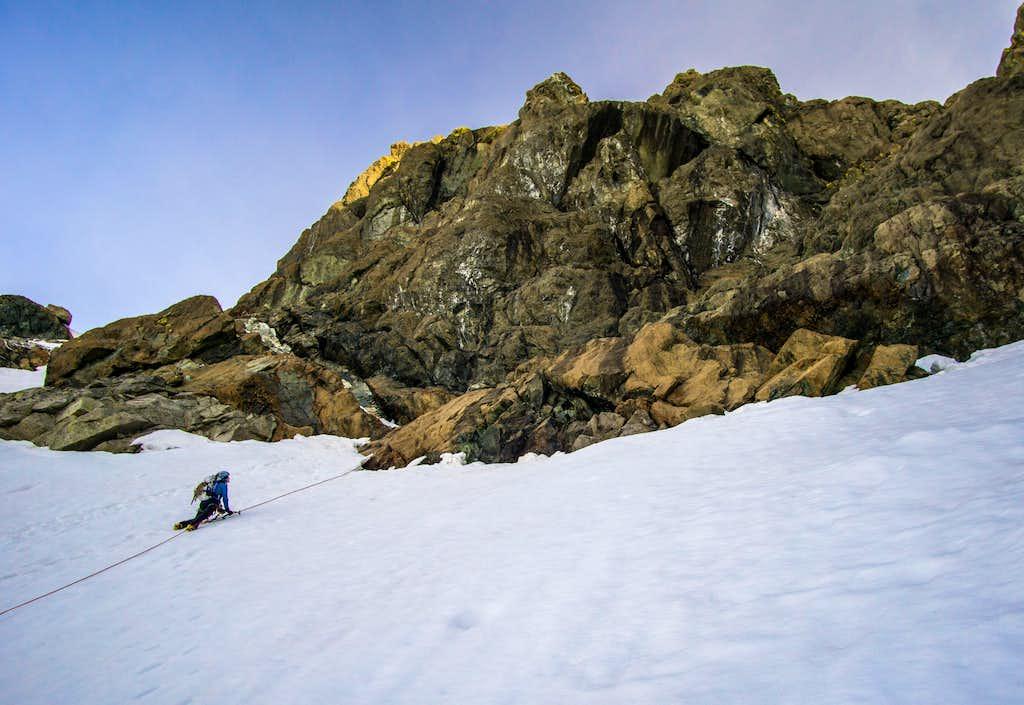 Melissa heading up snow field on East Ridge