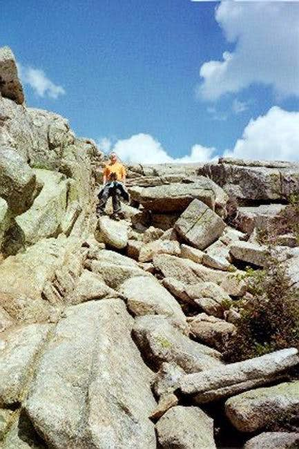 A steep rocky downclimb from...