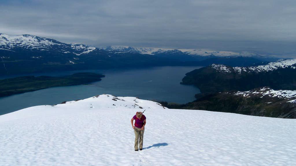 Jayme hiking up the snow ridge