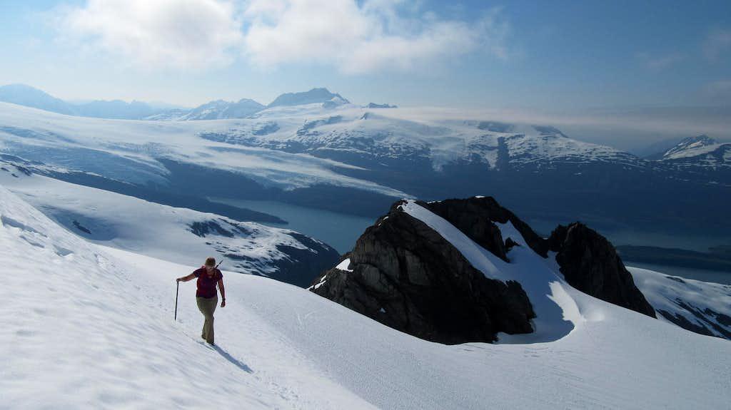Jayme traversing snow on Jatt Peak