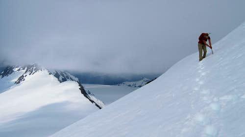 Traversing steep snow just below the summit of Jatt Peak