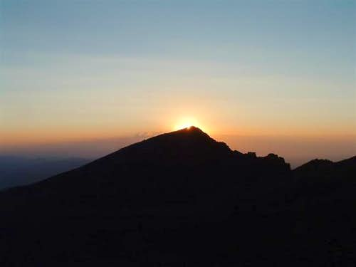 The sun rises behind Mt. Lady...
