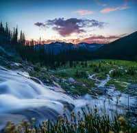 Sunset in front of the waterfall.