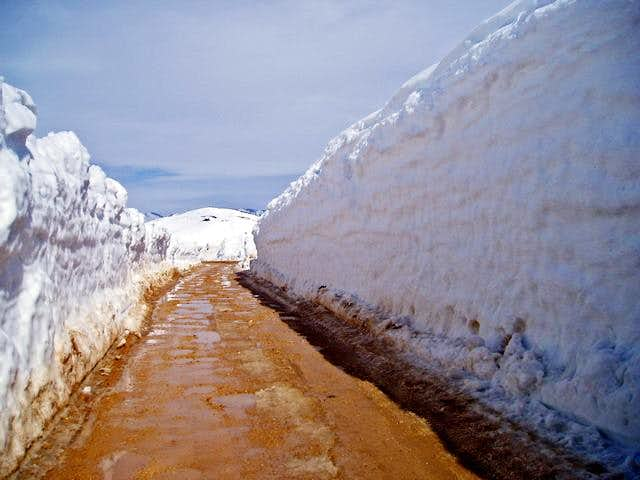 snow wall on the road to lake...