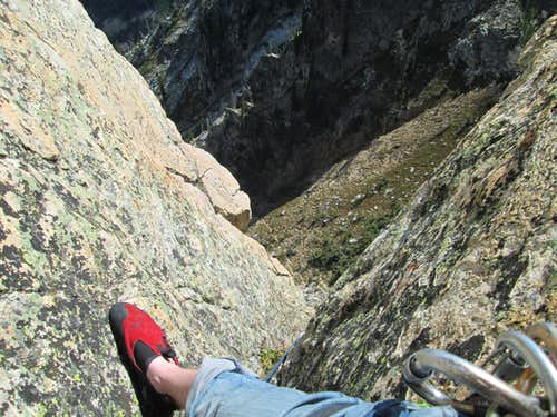 Looking down from the top of pitch 2, Southwest Ridge of Symmetry Spire, Teton Range, WY