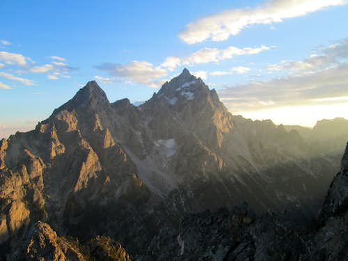 The Grand Teton and Teewinot seen from the summit of Symmetry Spire at sunset, Teton Range, WY