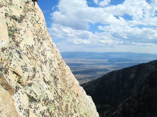 Looking out towards the valley floor from the top of pitch 2 of the Southwest Ridge of Symmetry Spire, Teton Range, WY