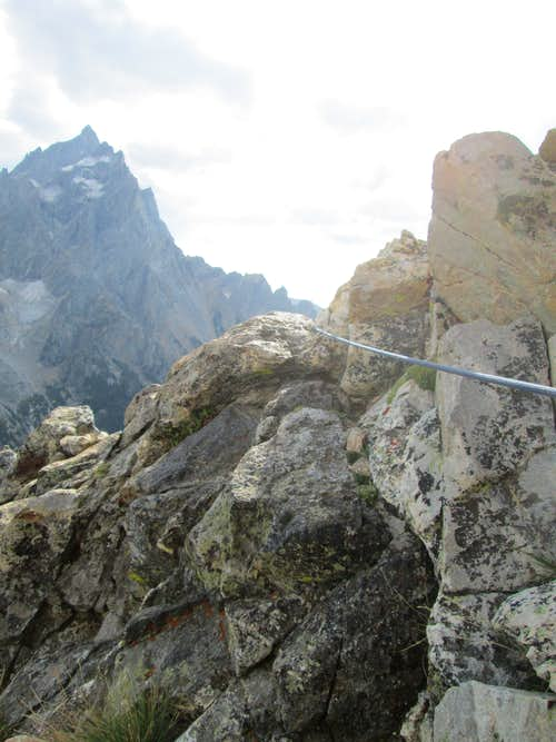 The rope trailing down the mountain from the belay at the base of pitch 4, Southwest Ridge of Symmetry Spire, Teton Range, WY
