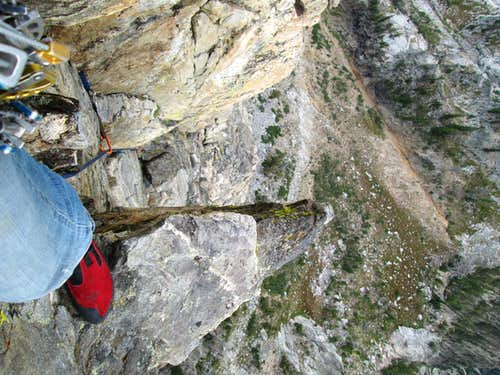 Looking down from near the top of the Southwest Ridge of Symmetry Spire on a pie piece shaped ledge, Teton Range, WY