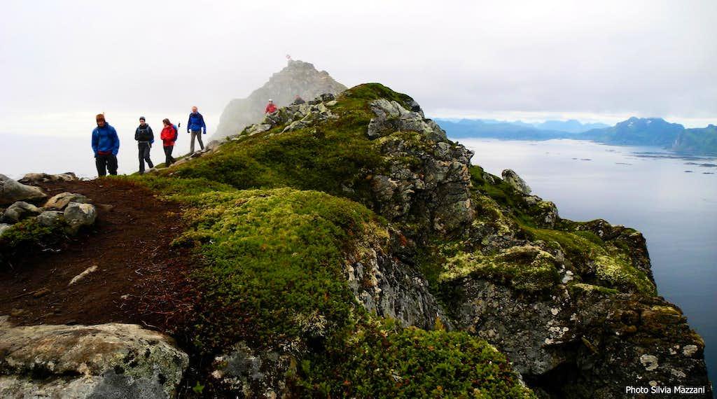 People on Festvågtinden summit crest