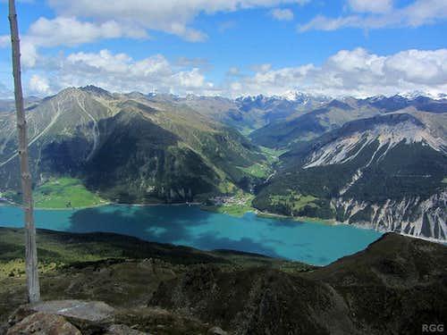 Zehnerkopf summit view to the Reschensee and the village of Graun