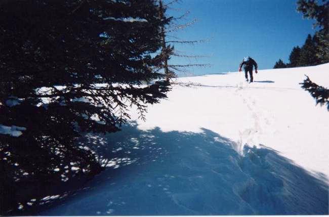 Jesus hiking the steep snow