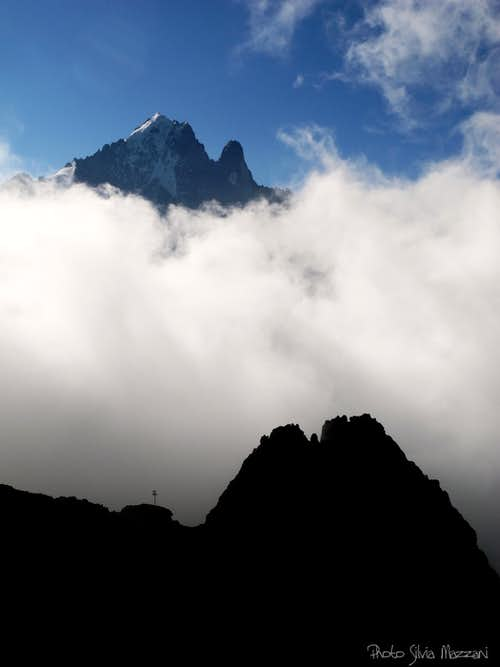 Petit Dru and Aiguille Verte stand out the clouds