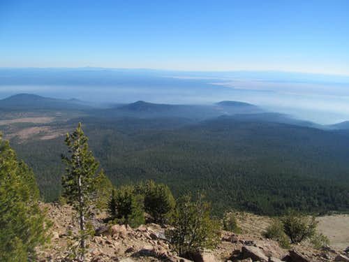 mist lined Crater Lake foothills