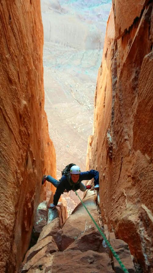 Myself stemming near the top of pitch 2, North Chimney, Castleton Tower, Utah