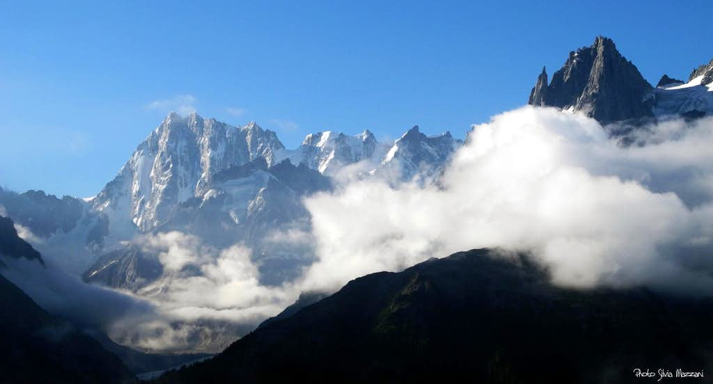 Grandes Jorasses on the left and Grands Charmoz (on the right) coming out the sea of clouds