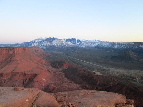 The La Sal Mountains seen from the top of Castleton Tower at sunset