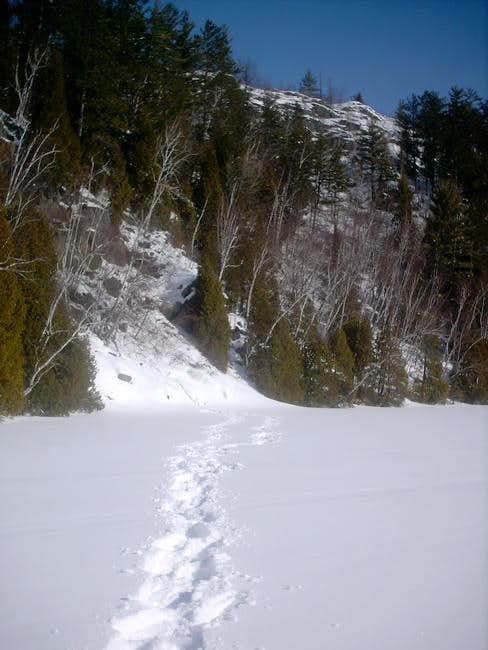 Snowshoeing by some cliffs...