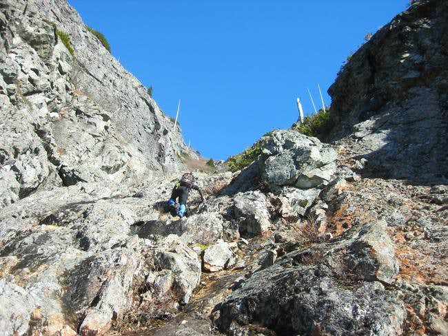 hikeing up the steep rock gully