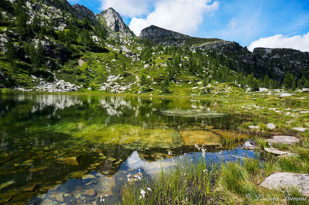 The SE-Face Cima del Masnee (2203m) reflecting in the Lake