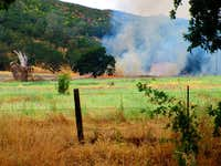 A controlled burn opposite the trailhead