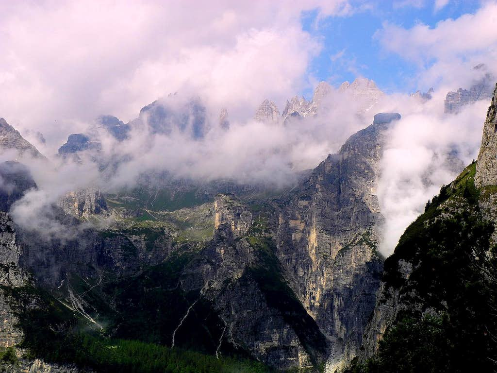 Brenta central sector emerging from clouds seen from the trail to Lasteri