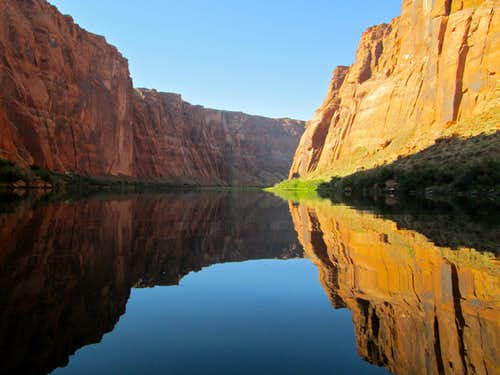 The walls of Lower Glen Canyon reflected off the Colorado River