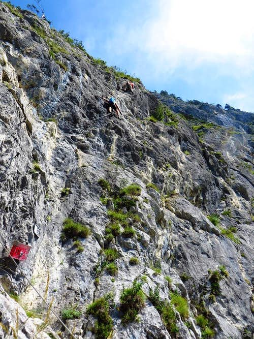 Climbers high on the Kaiser Max Klettersteig