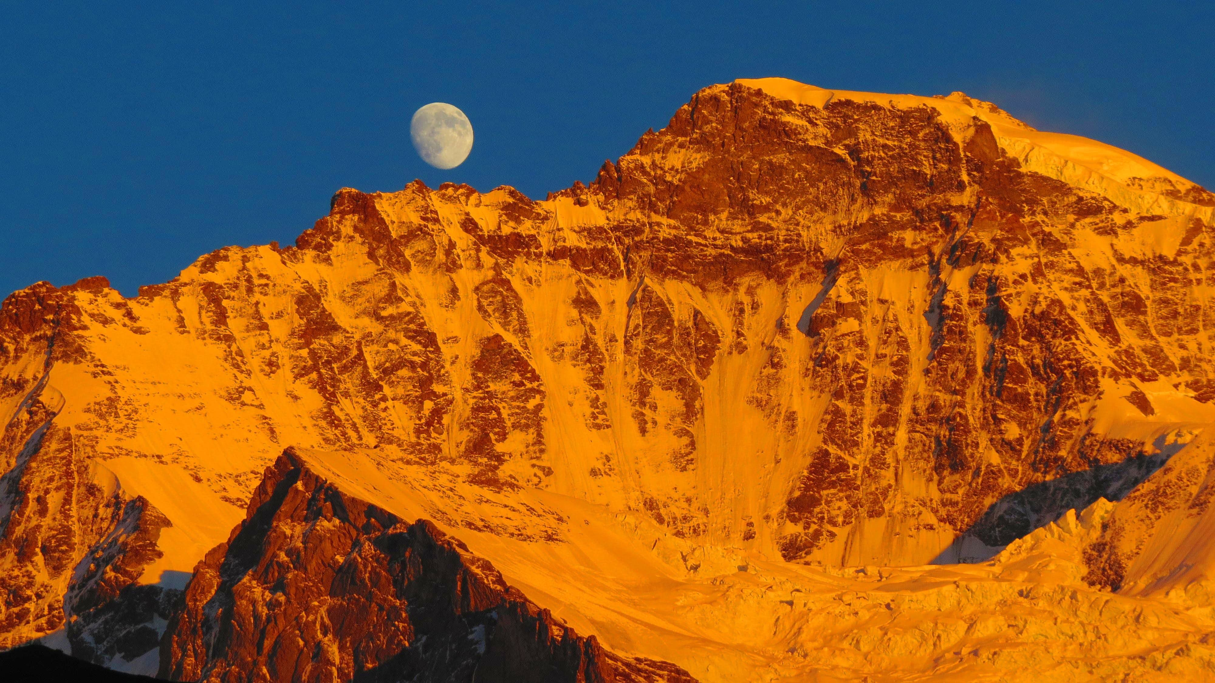 Moon rises up over Jungfrau west ridge