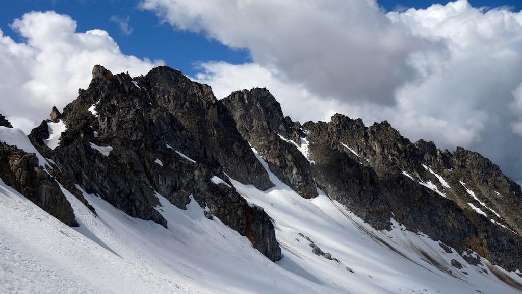 Traversing the upper Bomber Glacier below the ridge