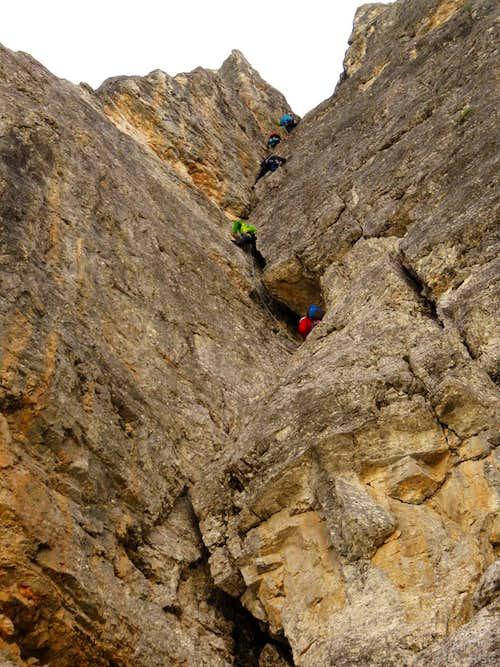 Climbers on Via del diedro, Torre Romana