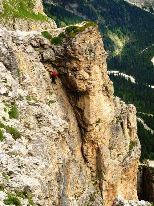 A climber high on the Trenker Crack route, 1st Sella Tower