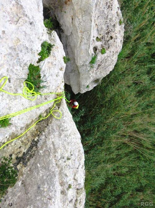 Jan rappels to the base of the Munxar Valley crags