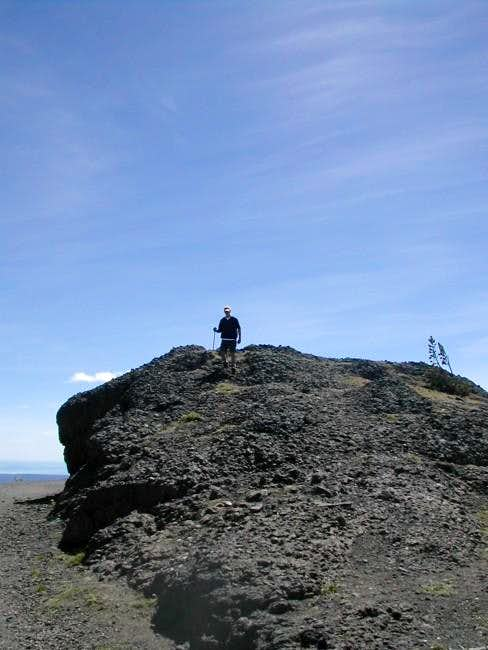 My son on top of rock cliff...
